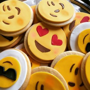Crowded close-up of emoji face cookies